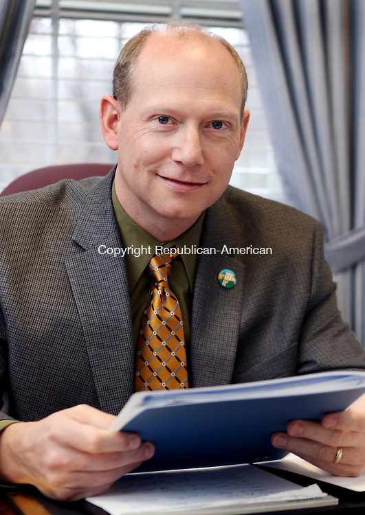 WINSTED CT. 01 DECEMBER 2015-120215SV03-Michael Rooke , president, Northwestern Connecticut Community College  works in his office in Winsted Wednesday.<br /> Steven Valenti Republican-American