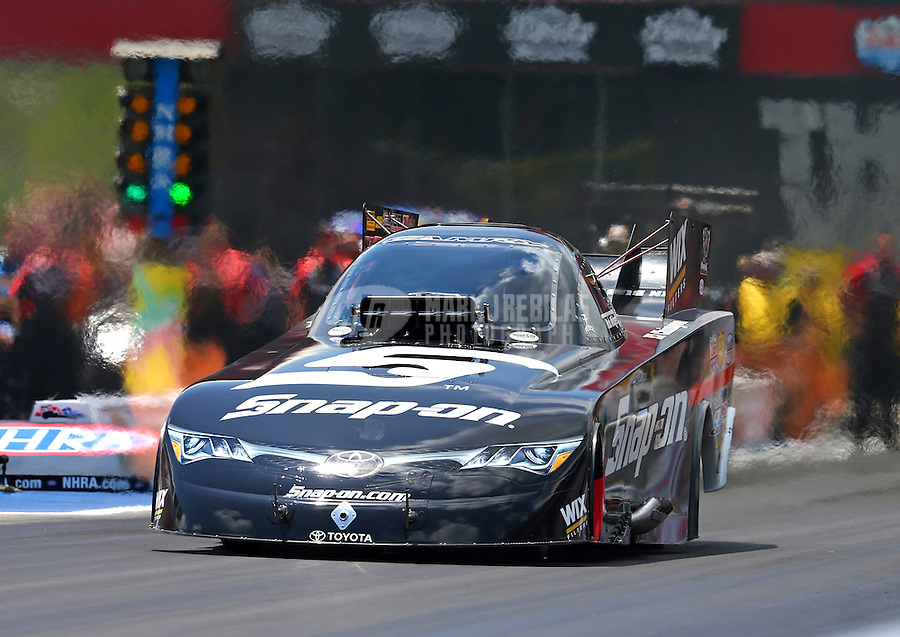 Jun 21, 2015; Bristol, TN, USA; NHRA funny car driver Cruz Pedregon during the Thunder Valley Nationals at Bristol Dragway. Mandatory Credit: Mark J. Rebilas-