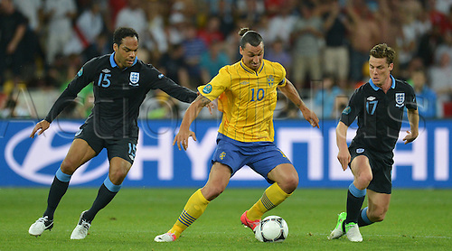 15.06.2012. Kiev, Ukraine.  Sweden's Zlatan Ibrahimovic (C) challenges for the ball with England's Joleon Lescott (L)and Scott Parker during the UEFA EURO 2012 group D soccer match Sweden vs England at NSC Olimpiyskiy Olympic stadium in Kyiv, Kiev, the Ukraine, 15 June 2012.
