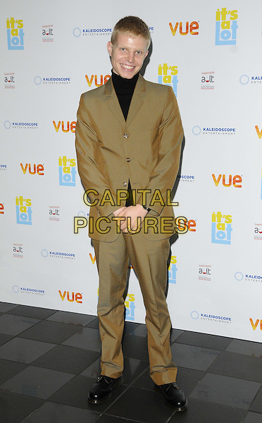 Charlie Palmer-Merkle<br /> The &quot;It's A Lot&quot; UK film premiere, Vue West End cinema, Leicester Square, London, England.<br /> October 21st, 2013<br /> full length black top beige brown suit  <br /> CAP/CAN<br /> &copy;Can Nguyen/Capital Pictures