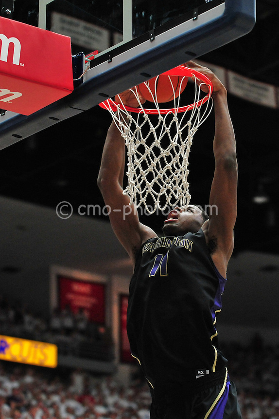 Feb 19, 2011; Tucson, AZ, USA; Washington Huskies forward Matthew Bryan-Amaning (11) dunks the ball in the 2nd half of a game against the Arizona Wildcats at the McKale Center.  The Wildcats won 87-86.