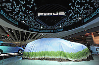 A car sits with a tarp over it in the Toyota showroom before the unveiling of a new hybrid Prius at the Detroit Auto Show in Detroit, Michigan on January 11, 2009.