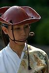 Sept 19, 2010- Miyayama, Kanagawa, Japan- A women horse-back archer at a Yabusame ritual at Samukawa Jinja Shrine.