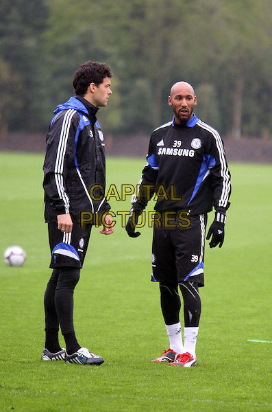 MICHAEL BALLACK & NICOLAS ANELKA.Chelsea Football Club training session  to preview Chelsea vs Arsenal at Chelsea's Training Ground in Cobham, England..April 17th, 2009.sport gesture soccer ball blue shorts footaballer full length black profile .CAP/DS.©Dudley Smith/Capital Pictures
