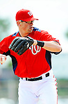 25 February 2012: Washington Nationals' infielder Tyler Moore takes some infield grounders during the first full squad Spring Training workout at the Carl Barger Baseball Complex in Viera, Florida. Mandatory Credit: Ed Wolfstein Photo