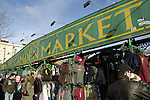 Large sign for Camden Market above clothing stalls, Camden Town, London