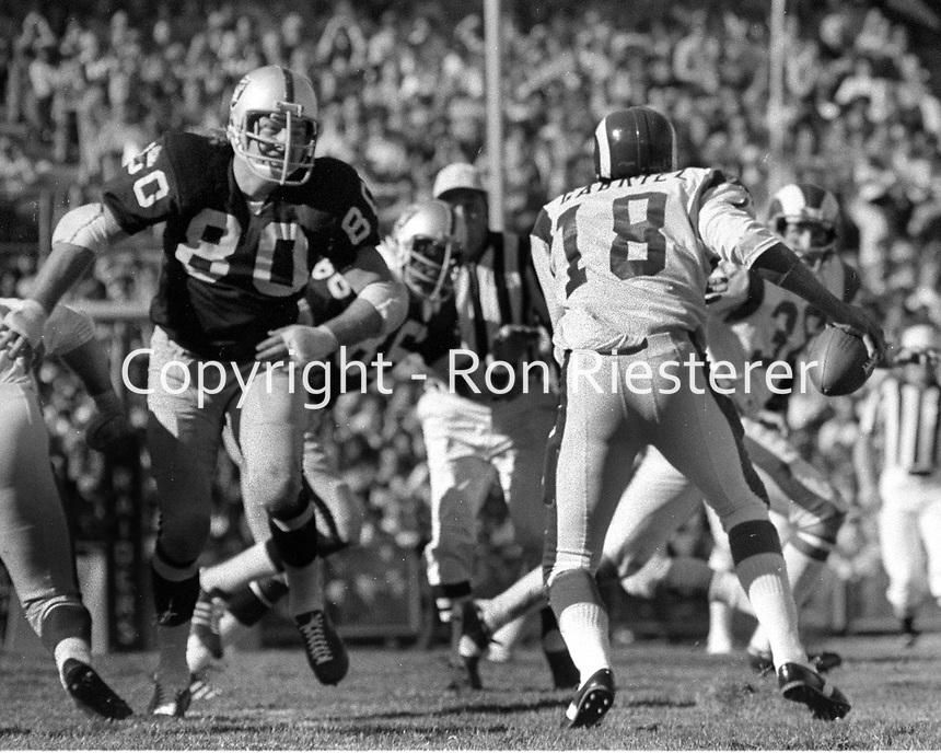 Raider Art Toms rush on Los Angeles Rams QB Roman Gabriel..(1972 photo/Ron Riesterer)