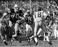 Raider Art Toms rush on Los Angeles Rams QB Roman Gabriel..(1972 photo/Ron Riesterer)