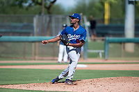 Los Angeles Dodgers relief pitcher Andre Jackson (15) follows through on his delivery during an Instructional League game against the San Diego Padres at Camelback Ranch on September 25, 2018 in Glendale, Arizona. (Zachary Lucy/Four Seam Images)