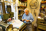 Jean Kazes, master Swiss clockmaker, at his studio in the Carouge neighborhood in Geneva, Switzerland, Europe