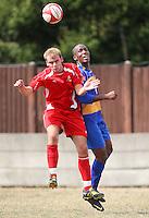Marc Gobel of Aveley heads clear from Dave Dalleba - Romford vs Aveley - Pre-Season Friendly Match at Mill Field, Aveley FC - 31/07/10 - MANDATORY CREDIT: Gavin Ellis/TGSPHOTO - Self billing applies where appropriate - Tel: 0845 094 6026