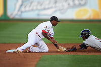 Peoria Chiefs second baseman Darren Seferina (3) swipes the tag as Sthervin Matos (9) slides into second during a game against the Wisconsin Timber Rattlers on August 21, 2015 at Dozer Park in Peoria, Illinois.  Wisconsin defeated Peoria 2-1.  (Mike Janes/Four Seam Images)