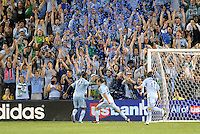 Graham Zusi celebrates the opening goal for Sporting KC in front of the Cauldron end of the stadium... Sporting Kansas City defeated New England Revolution 3-0 at LIVESTRONG Sporting Park, Kansas City, Kansas.