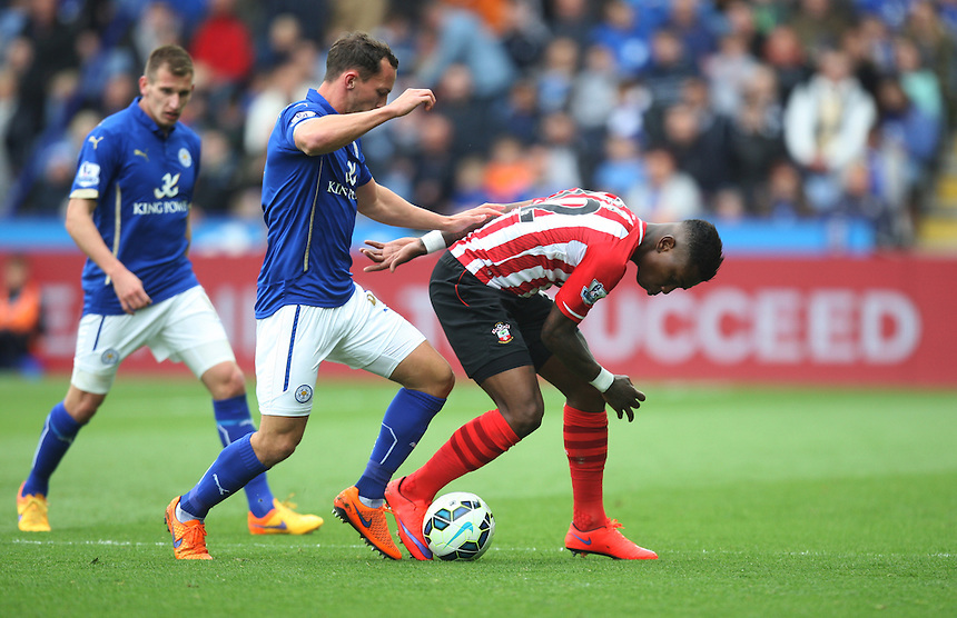 Leicester City's Daniel Drinkwater (C) tackles Southampton's Eljero Elia (R)<br /> <br /> Photographer Jack Phillips/CameraSport<br /> <br /> Football - Barclays Premiership - Leicester City v Southampton - Saturday 9th May 2015 - King Power stadium - Leicester<br /> <br /> &copy; CameraSport - 43 Linden Ave. Countesthorpe. Leicester. England. LE8 5PG - Tel: +44 (0) 116 277 4147 - admin@camerasport.com - www.camerasport.com