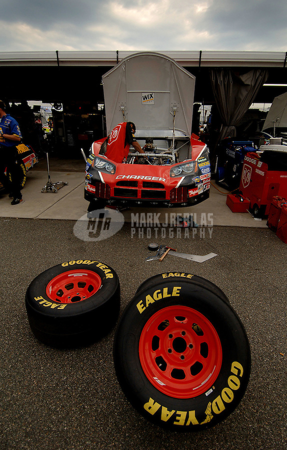May 5, 2006; Richmond, VA, USA; Crew members for Nascar Nextel Cup driver Jeremy Mayfield (19) work on his car prior to practice for the Crown Royal 400 at Richmond International Raceway. Mandatory Credit: Mark J. Rebilas..
