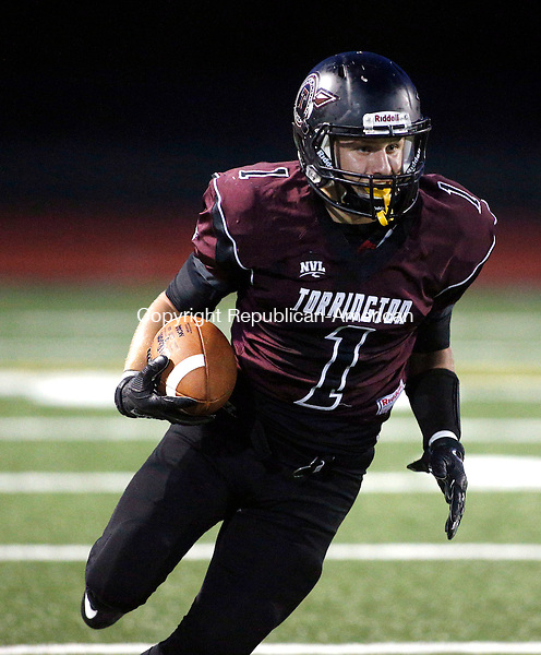 Torrington, CT- 25 September 2015-092515CM05-  action man---  Torrington's Zak Mancinni carries the ball during their NVL matchup against Naugatuck in Torrington on Friday.      Christopher Massa Republican-American