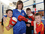 Luke Maguire, Ross Coyle and Andrew Blak pictured with Boxer Deirdre Gogarty at her book signing at Drogheda Boxing club. Photo: Colin Bell/pressphotos.ie