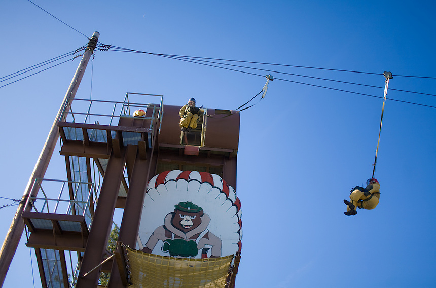 Smokejumpers at the base in McCall, ID practicing jumpint out of a 35-foot high tower and slide along a zip line.