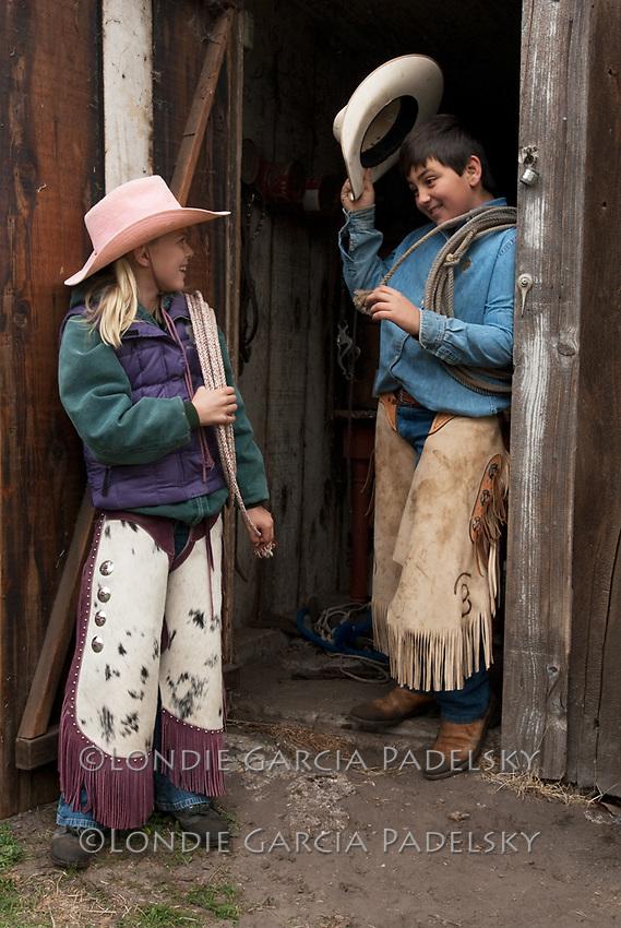 Young cowboy greets cowgirl. San Luis Obispo, California.