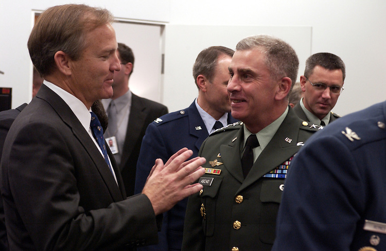 Ranking member Chet Edwards, D-TX., talks with Gen. John Abizaid - commander, U.S. Central Command before the start fo the military construction subcommittee of House Appropriations Committee hearing on 2005 appropriations for programs under its jurisdiction.