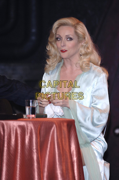 """JANE KRAKOWSKI.""""Guys & Dolls"""" production photocall,.Piccadilly Theatre, Denman Street, London, .May 31st 2005..Ref: PL.half length stage costume sitting at table.www.capitalpictures.com.sales@capitalpictures.com.©Capital Pictures"""