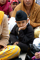 """Rome April 30 2006  .Piazza Vittorio  .Sikh """"Punj Pyare"""" (Five Beloved Ones) lead a religious parade.The parade is for Visaki, a traditional Sikh celebration..Sikh child ."""