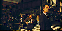 Tokyo - January 2008 - Japan<br /> <br /> People waiting to cross the street , Akihabara district<br /> <br /> <br /> &copy; Alessandro Rizzi / GraziaNeri