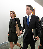 Judge Brent Kavanaugh and his wife, Ashley, hold hands as they walk in the hallway prior to the hearing where he will attempt to refute the testimony of Dr. Christine Blasey Ford  before the US Senate Committee on the Judiciary on his nomination to be Associate Justice of the US Supreme Court to replace the retiring Justice Anthony Kennedy on Capitol Hill in Washington, DC on Thursday, September 27, 2018.  <br /> Credit: Ron Sachs / CNP<br /> (RESTRICTION: NO New York or New Jersey Newspapers or newspapers within a 75 mile radius of New York City)