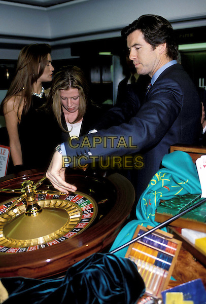 PIERCE BROSNAN    .Ref: 883.gambling,  roulette, casino, half length, half-length.*RAW SCAN - photo will be adjusted for publication*.www.capitalpictures.com.sales@capitalpictures.com.© Capital Pictures