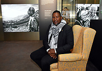 Nelson Mandela&rsquo;s grandson, Nkosi Zwelivelile Mandela sitting on Nelson Mandela's favourite yellow armchair from his home in rural South Africa, at Press view for exhibition celebrating the life and legacy of Nelson Mandela, the anti-apartheid revolutionary and former President of South Africa, showcasing personal belongings and objects.  Nelson Mandela The Official Exhibition press view, London, UK - 7 February 2019.<br /> CAP/JOR<br /> &copy;JOR/Capital Pictures