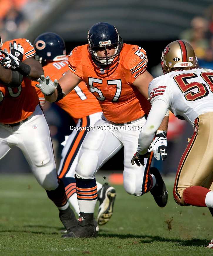 Center Olin Kruetz #57 of the Chicago Bears prepares to block a  San Francisco 49ers defender on November 13, 2005 at Soldier Field in Chicago, Illinois. The Bears defeated the 49ers 17-9. (Photo by David Stluka)