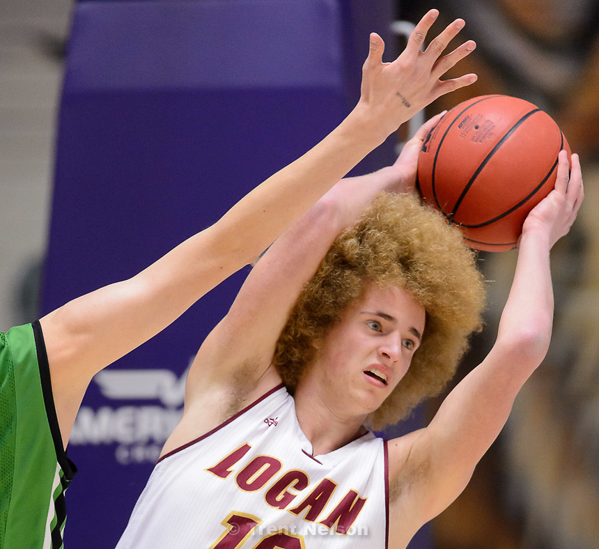 Trent Nelson  |  The Salt Lake Tribune<br /> Logan's Jaden Frazier (12) looks to get rid of the ball as Provo faces Logan High School in the state 4A boys basketball tournament at the Dee Events Center in Ogden, Tuesday February 24, 2015.