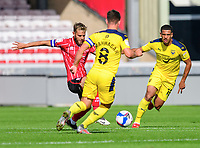 Lincoln City's Jorge Grant vies for possession with Oxford United's Cameron Brannagan<br /> <br /> Photographer Chris Vaughan/CameraSport<br /> <br /> The EFL Sky Bet League One - Saturday 12th September 2020 - Lincoln City v Oxford United - LNER Stadium - Lincoln<br /> <br /> World Copyright © 2020 CameraSport. All rights reserved. 43 Linden Ave. Countesthorpe. Leicester. England. LE8 5PG - Tel: +44 (0) 116 277 4147 - admin@camerasport.com - www.camerasport.com - Lincoln City v Oxford United