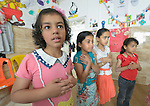 War-weary children in Rafah, in the south of Gaza, participate in a psychosocial program run by the Department of Service for Palestinian Refugees of the Near East Council of Churches, a member of the ACT Alliance, , and funded in part by the Pontifical Mission for Palestine. The program is designed to help the children cope better with stress caused by the 2014 war with Israel and the continuing hardship provoked by the Israeli siege of the Palestinian territory.