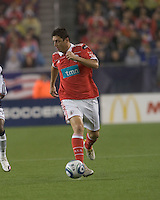 SL Benfica midfielder Filipe Menezes (24) dribbles. SL Benfica  defeated New England Revolution, 4-0, at Gillette Stadium on May 19, 2010.