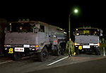 Members of Japan's Ground Self Defense Forces gather at a highway service station in Fukushima on their way to perform post-quake emergency work  in Tohoku, Japan on 12 March, 2011. .Photographer: Robert Gilhooly