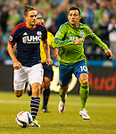 Seattle Sounders Marco Pappa (10) chases New England Revolution Kelyn Rowe (11) during an MLS match on March 8, 2015 in Seattle, Washington.  The Sounders beat the Revolution 3-0.  Jim Bryant Photo. ©2015. All Rights Reserved.