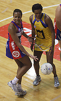 Mystics goal attack Pamela Cookey queries an umpiring decision alongside Pulse goalkeep Althea Byfield during the ANZ Netball Championship match between the Central Pulse and Northern Mystics, TSB Bank Arena, Wellington, New Zealand on Monday, 4 May 2009. Photo: Dave Lintott / lintottphoto.co.nz