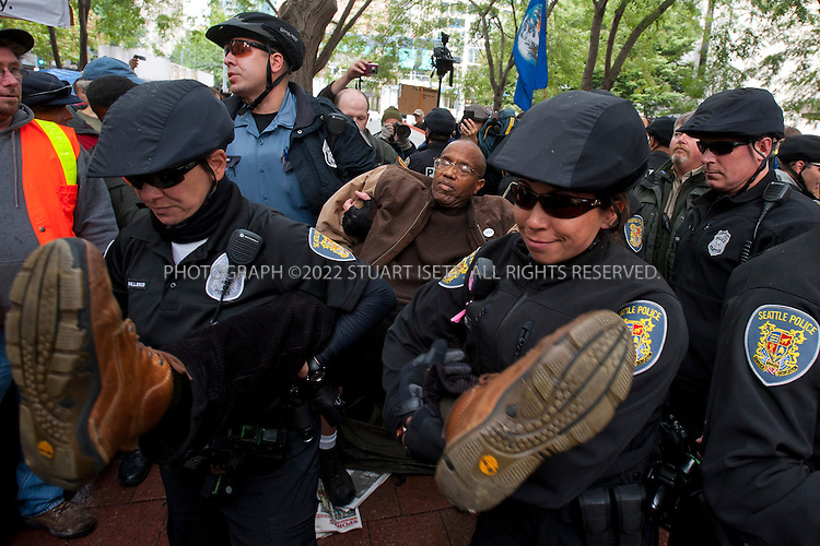 "10/5/2011--Seattle, WA, USA..The Seattle Police Department today arrested numerous Occupy Seattle protesters who had set up tents in Westlake Park in the heart of the city. After ordering protesters to remove the tents, police arrested those who refused to remove their them from the public park. Over 100 protesters were at the event, an offshoot of the Occupy Wall Street  and ""99-1"" protest that is ongoing in New York City. ...©2011 Stuart Isett. All rights reserved"