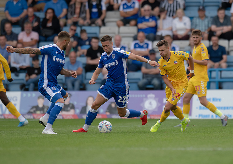 Gillingham's Olly Lee (centre) under pressure from Bolton Wanderers' Dennis Politic (right) <br /> <br /> Photographer David Horton/CameraSport<br /> <br /> The EFL Sky Bet League One - Gillingham v Bolton Wanderers - Saturday 31st August 2019 - Priestfield Stadium - Gillingham<br /> <br /> World Copyright © 2019 CameraSport. All rights reserved. 43 Linden Ave. Countesthorpe. Leicester. England. LE8 5PG - Tel: +44 (0) 116 277 4147 - admin@camerasport.com - www.camerasport.com