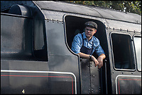 BNPS.co.uk (01202)558833<br /> Pic: PhilYeomans/BNPS<br /> <br /> Locomotive fireman Will Armston-Sheret learns the ropes.<br /> <br /> Growth Industry - Britain's enduring love affair with steam trains has led to a critical shortage of drivers, 56 years after the infamous Beeching Axe was supposed to have fallen.<br /> <br /> More steam train's are running today than at anytime since Dr Beechings drastic cut in 1963 - with over 150 steam heritage railways and museums attracting 13 million visitors a year.<br /> <br /> One of the most popular heritage railways in the country has put out an SOS for steam drivers - as so many of its stalwarts are retiring.<br /> <br /> Swanage Railway in Dorset has 42 steam drivers on their books, but the majority are in their 60s or older and likely to step down in the coming years.<br /> <br /> They need to train up to 40 drivers over the next five years to replace them and meet their expanding service, which attracts over 200,000 visitors each year.<br /> <br /> To fill the void, a group of enthuisastic young volunteers are being taught the skill, a process which can take up to a decade.<br /> <br /> The Heritage Railway Association, which oversees them, says some of their railways have a 'more pressing need for new blood'.