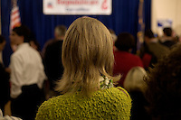 A woman waits for the next speaker at the Hillsborough County Republican Gala at the Crowne Plaza Hotel in Nashua, New Hampshire, on Jan. 6, 2012. Former congressmen Rick Santorum and Newt Gingrich spoke at the event. Both are seeking the 2012 Republican presidential nomination.