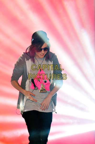 LADY SOVEREIGN (Louise Harman).Contestants enter the House on the Opening Night of Celebrity Big Brother, Elstree Studios, London, England..January 3rd, 2010.CBB BB half length sunglasses shades  trainers baseball cap hat grey gray t-shirt hoodie black jeans denim pink white Sov hands.CAP/PL.©Phil Loftus/Capital Pictures.