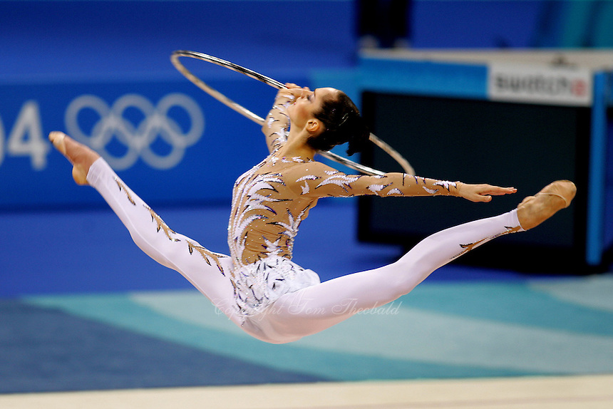 Anna Bessonova of Ukraine split leaps with hoop during qualifications round at 2004 Athens Olympic Games on August 26, 2006 at Athens, Greece. (Photo by Tom Theobald)