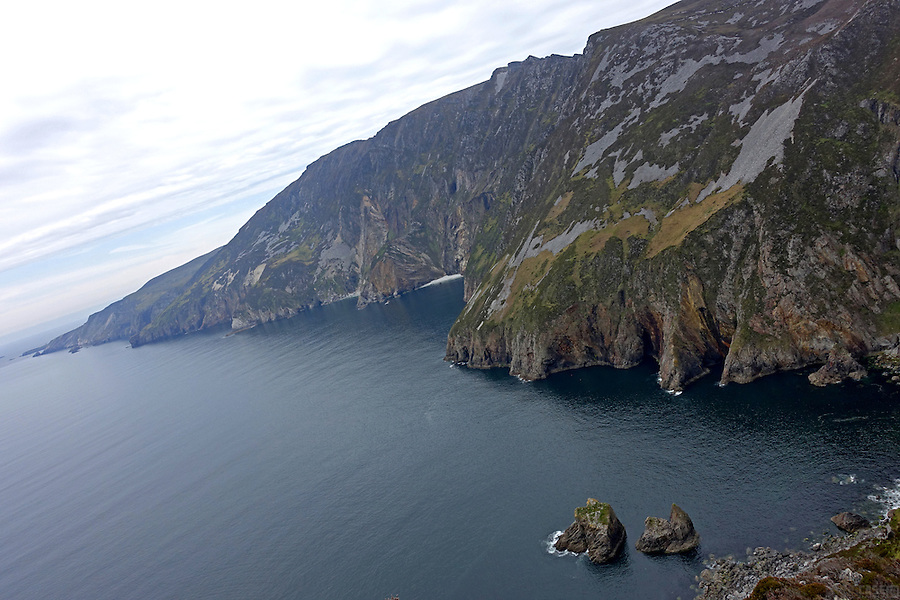 Hiking at Slieve League, County Donegal, Ireland. At 601 meters (1,972 ft), these are some of the highest sea cliffs in Ireland. Although less famous than the Cliffs of Moher in County Clare, Slieve League's cliffs reach almost three times higher.