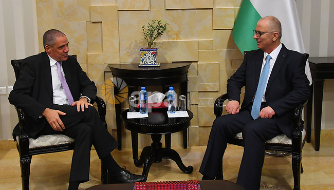 Palestinian Prime Minister, Rami Hamdallah, meets with EU representative to Palestine Ralph Trav, in the West Bank city of Ramallah, on January 30, 2019. Photo by Prime Minister Office
