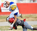 Borgia wide receiver Brandon Mitchell (top) is tackled by Roosevelt quarterback Alonzo Smith. Roosevelt defeated Borgia in a Class 3 District 2 football game at Roosevelt HS in St. Louis on Saturday November 16, 2019. <br /> Tim Vizer/Special to STLhighschoolsports.com