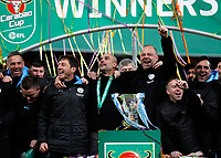 1st March 2020; Wembley Stadium, London, England; Carabao Cup Final, League Cup, Aston Villa versus Manchester City; Manchester City Manager Pep Guardiola alongside his coaching staff on the winners podium celebrating with the EFL Cup Trophy