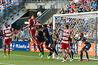 Blas Perez (7) of FC Dallas scores off a header as Jeff Parke (31) and Sheanon Williams (25) of the Philadelphia Union defend. The Philadelphia Union and FC Dallas played to a 2-2 tie during a Major League Soccer (MLS) match at PPL Park in Chester, PA, on June 29, 2013.