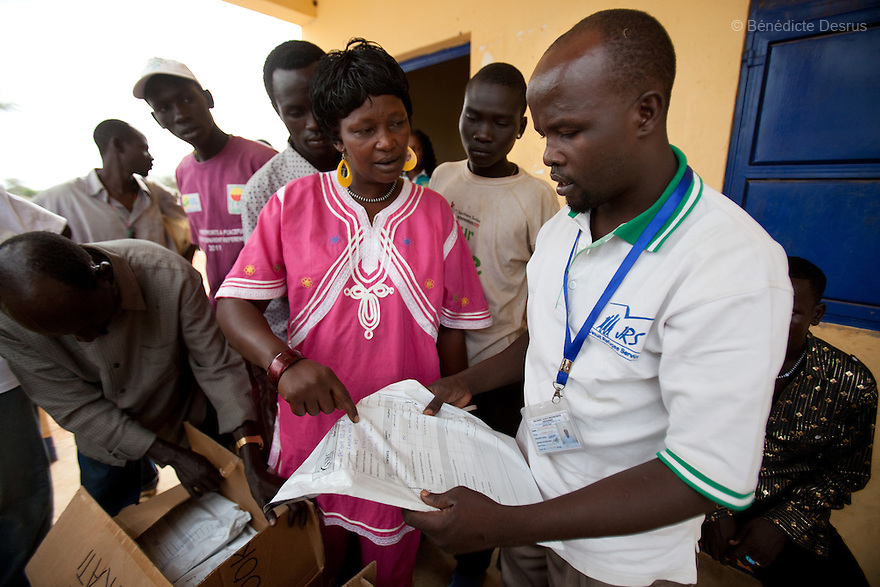11 december 2010 - Riwoto, South Sudan - Scolastica Adukan (L) from the County referendum Sub-committee of Kapoeta North County and Lopeta Philemon Lokai (R), training officer for the Southern Sudan Referendum Comission check completed registration materials at Riwoto, Eastern Equatoria State, South Sudan. The referendum is scheduled to take place on January 9, 2010. Photo credit: Benedicte Desrus